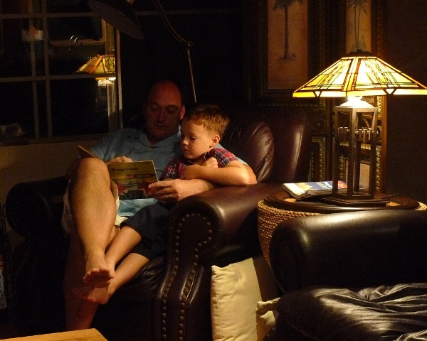 Daddy still feeling pretty sick, but reading Sam one of his favorite books.