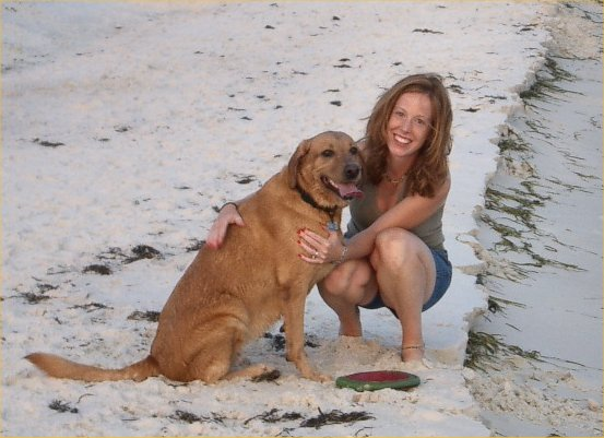 Doggie girl having the time of her life on Pensacola beach in 2003 enroute to CA. See frisbee?
