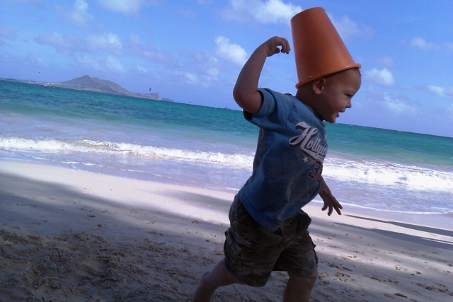 Ben and I bumped into our appraiser and her son on the beach today! The boys had a lot of fun messing around with buckets on their head - putting them on like hats, chasing, taking them off and tossing them to the ground, then giggling. I couldn't get them both in a decent shot on my new little phone (slooooow shutter) but did get this cute one of Ben :)