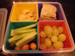 Bento box lunch! Carbs (whole grain omega-3 fortified bread with yogurt spread and honey); hummus; veggies; fruit; and Hershey's kisses (not shown).
