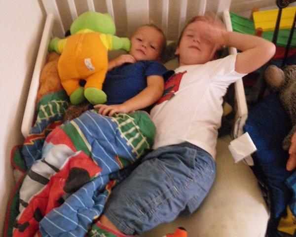 After waffles for breakfast, then some ball playing, drumming and guitar-ing, it grew quiet in the house. I went back to see what was going on and here's what we found - two boys cuddled up for quiet time in Ben's bed! SO cute!