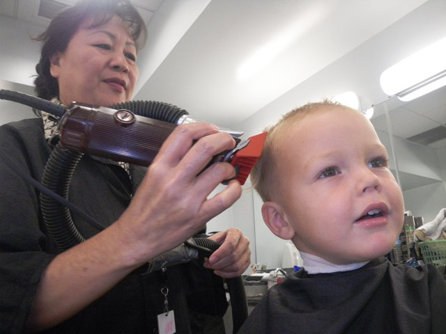 Ben decided he was ready for first haircut. I think he really wanted a lollipop and was really ok with doing just about anything to get one. All three boys got a haircut at the same time :)