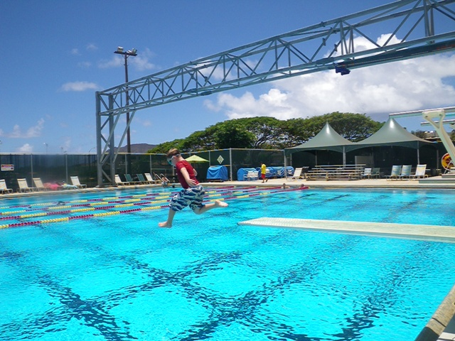 Sam passed his swim test today so he was able to take his first jump off a diving board, too!