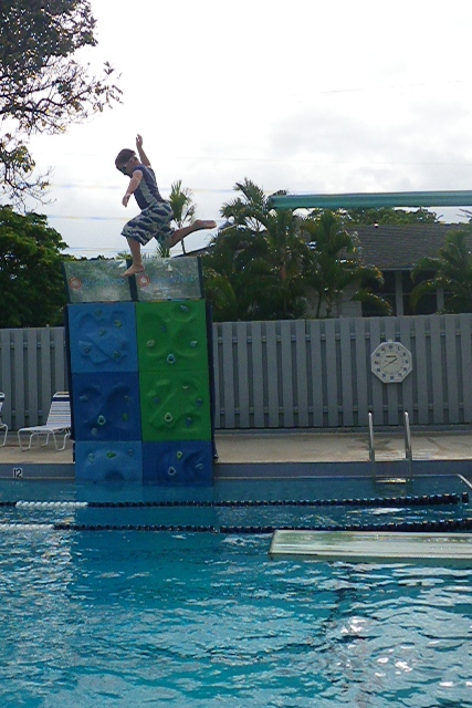 """Sam jumping off the high dive - I think this is the second of 17 or more jumps. He came up with a huge smile after his first jump and said """"I LUUUUUV the high dive!"""""""