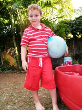 Sam with a very special ball - mailed to him from our friend Janine-Anne, who was our post lady in Coronado, five years ago when he was born. It is just this year starting to lose a bunch of air. We'll try to resuscitate it and see how long it can last!