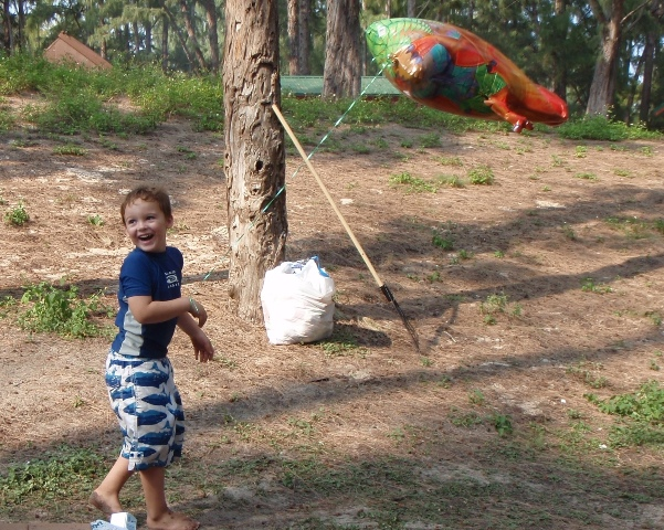 Sam and his dino balloon taking a tour of the campsite!