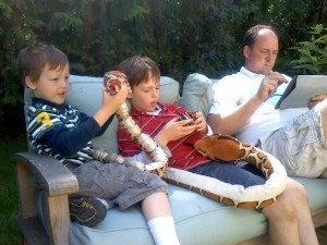 Sunday afternoon cubing and snake talking. I taught Ben about symmetry - one snake is more symmetrical than the other. The python (in Sam's lap) appears to be smiling on one side of his face but not the other. Dave is testing how to send pictures to my mom with his iPad.