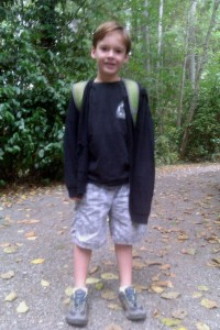 First day of school for Sam in 2011 - first grade. He's wearing an Eddie Aikou surf shirt.