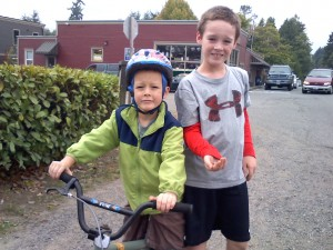 Out on a bike/run with my boys. Sam found some nuts and washers on the side of the road, so of course we ran home with those in hand. Ben is learning to brake - there are a LOT of hills here. Serious ones. He's on a bigger bike with a hand brake now.