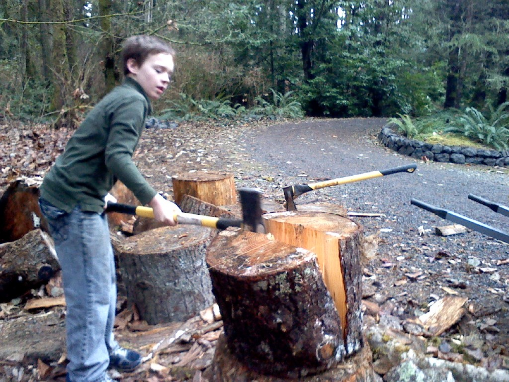 Chopping some wood together! Sam is finishing this one off with Dave's axe.
