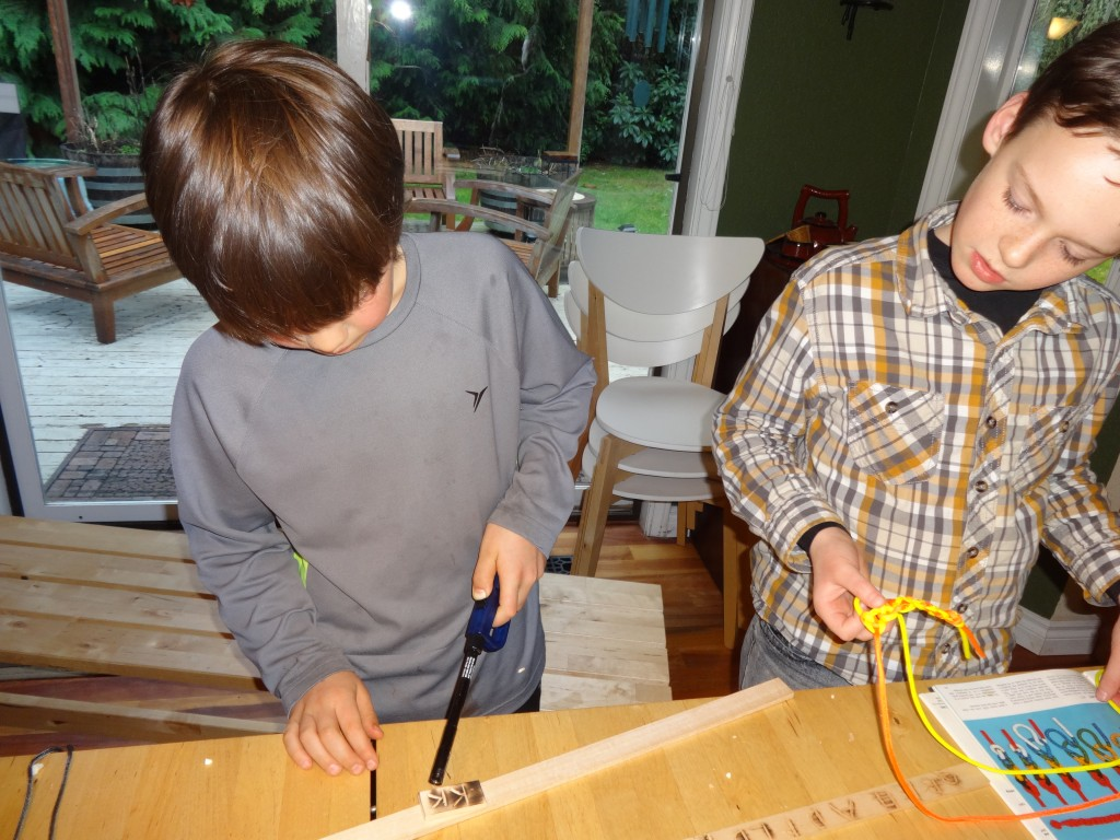 Burnishing our carved valentines. Sam is making a rope bracelet.