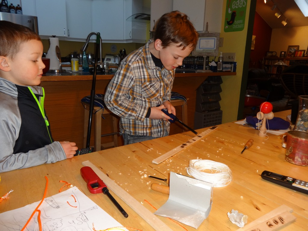 Sam is now burnishing his carved valentines. One set of initials for each person in the class.