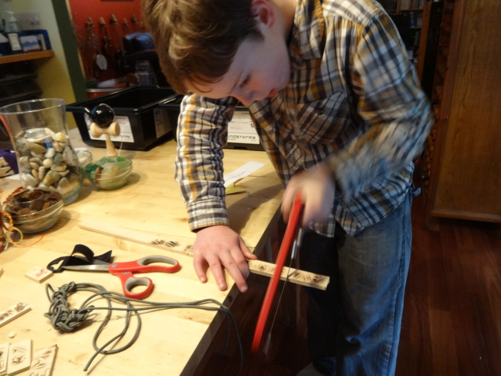 Cutting each carving with a new coping saw.