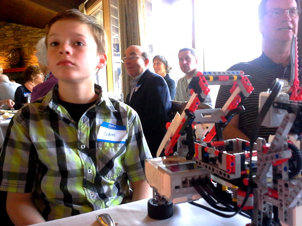 Sam was invited to a Rotary Luncheon in honor of recent grant recipients. He brought his cube-solving robot to illustrate what the funds are helping students do. He raced the robot while the remarks were being made about the grant. The Rotarians were so gracious in their warm welcome, and the pair (Sam and his robot) were show-stoppers. He enjoyed the buffet, too :)