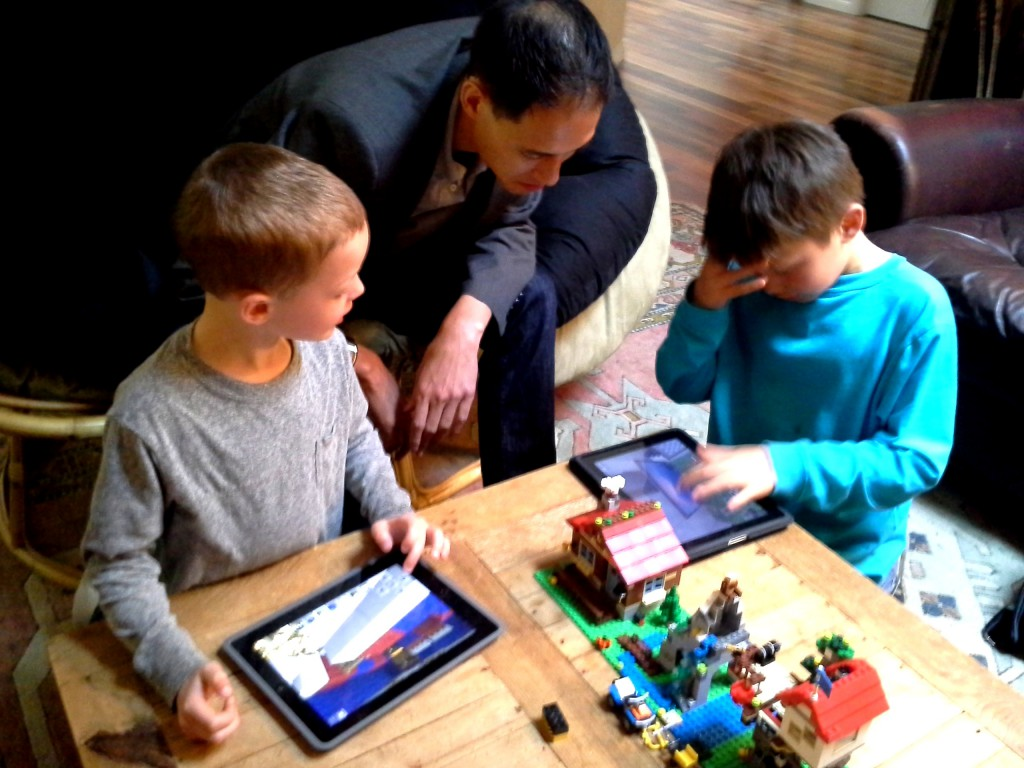 Ben and Kai showing Paulo Minecraft. Can you believe it - we're able to show Paulo something?