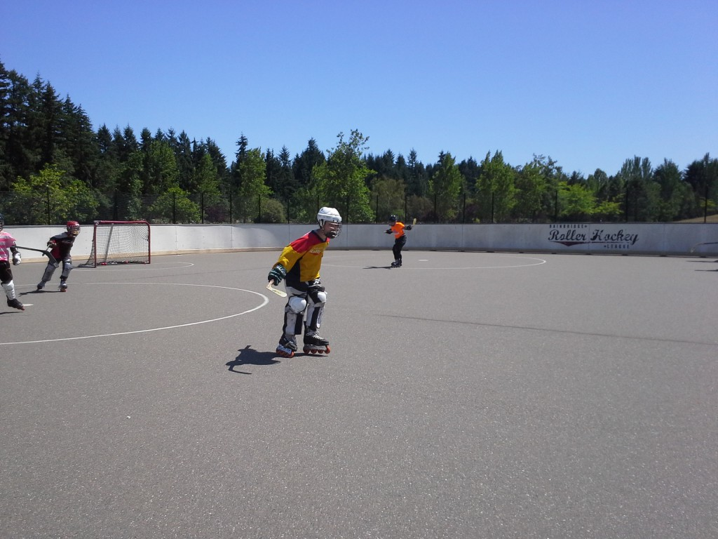 Sam at hockey in the blazing sun. What I would give for an ice rink anywhere near Bainbridge. Sam LOVES roller hockey, though, and has gotten so good at skating it's unreal. The league is fantastic! Such nice people.