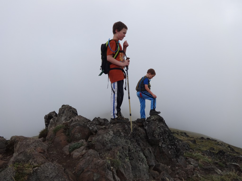 We're there! We should have miles and miles of views, but today we don't - instead we get the dramatic movement of clouds up and over the summit saddle. We also get to focus much closer at hand - the antics of funny boys!