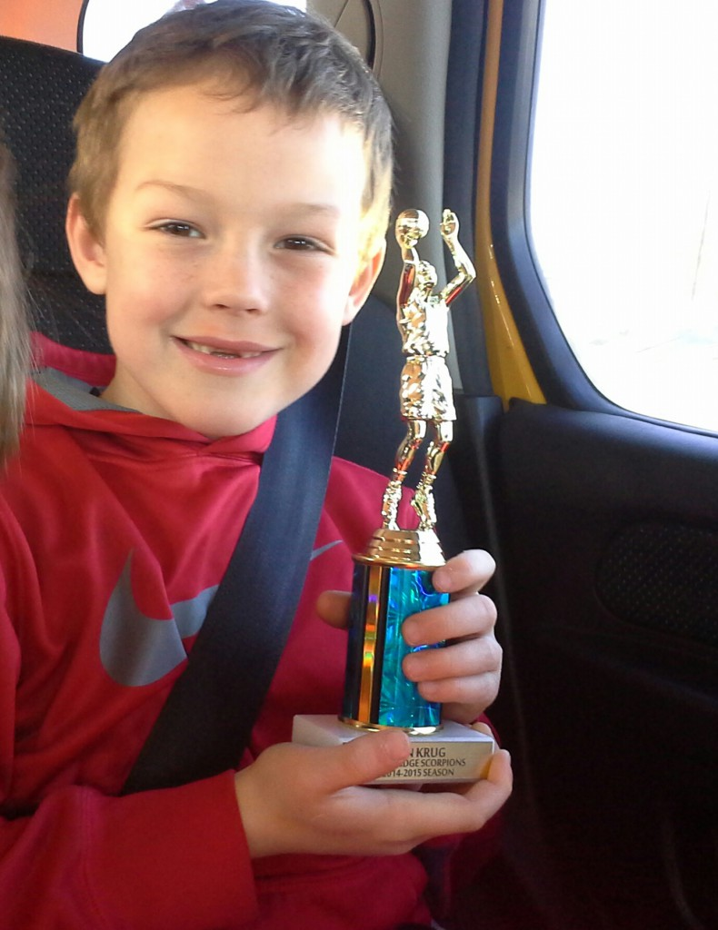 Ben showing his trophy while we are on our way to hockey playoffs! Ben's team played their last game Sat morning, then we went for team lunch and awards, then hopped the ferry for Sam's game. Can you believe it?