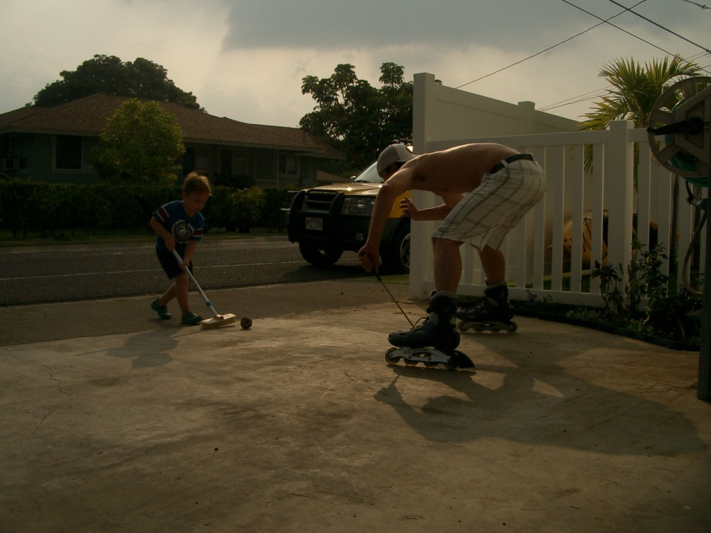 Uncle Tim was visiting for a month, and flew home the morning I went into labor. This is where hockey all started - a broom, a golf club, and a ball on our tiny driveway!