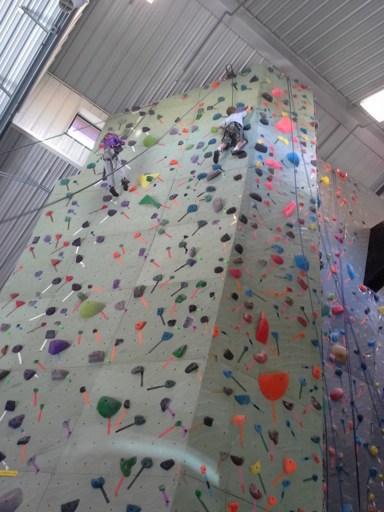 Ben is climbing all the way up to the top! He is so brave! I don't think I could do this. It's a local climbing gym. I may need to try for my birthday. I always do something that I'm nervous about doing on my birthday. It's a tradition...Maybe Ben will coach me?