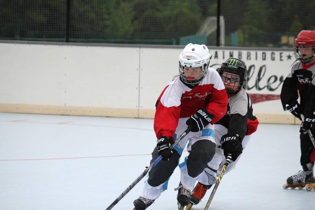 Sam's good ice hockey friend Dillon Peterson on the other team, chasing him down!