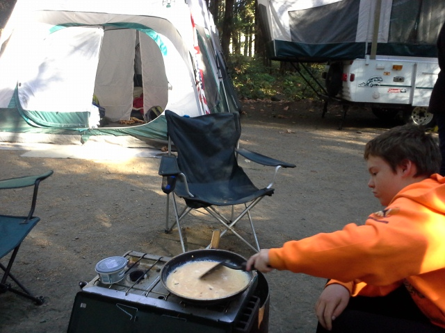 Sam loves to make the eggs. He's quite a good egg scrambler these days. Mom and Richard - the tent is huge, but has wonderful features. That door - genius!