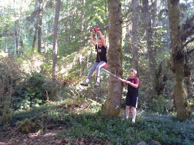 New zip line installed - it's a huge hit! And a good workout hauling your buddy up for a ride :)
