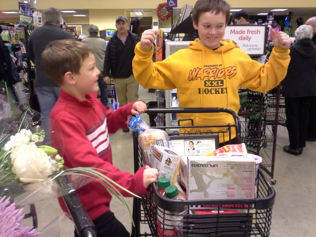 Shopping for all the fixin's with Sam and Ben the day before Thanksgiving, after giving them frozen yogurt for lunch, AND allowing them to each have a cart. Maybe not a good idea, but they were model boys! No one got hurt, no one got admonished, and they found the things they were sent after. We DID come home with enough to make FOUR pies, but that's ok. We'll get to that. I make a decent crust and it's fun to do over the weekend. (Between hockey games? Huh...) On the way out of the store we raced shopping carts down the parking lot. There's a nice slope for coasting. Yes, I was safe. :) Turns out you can steer with your feet!