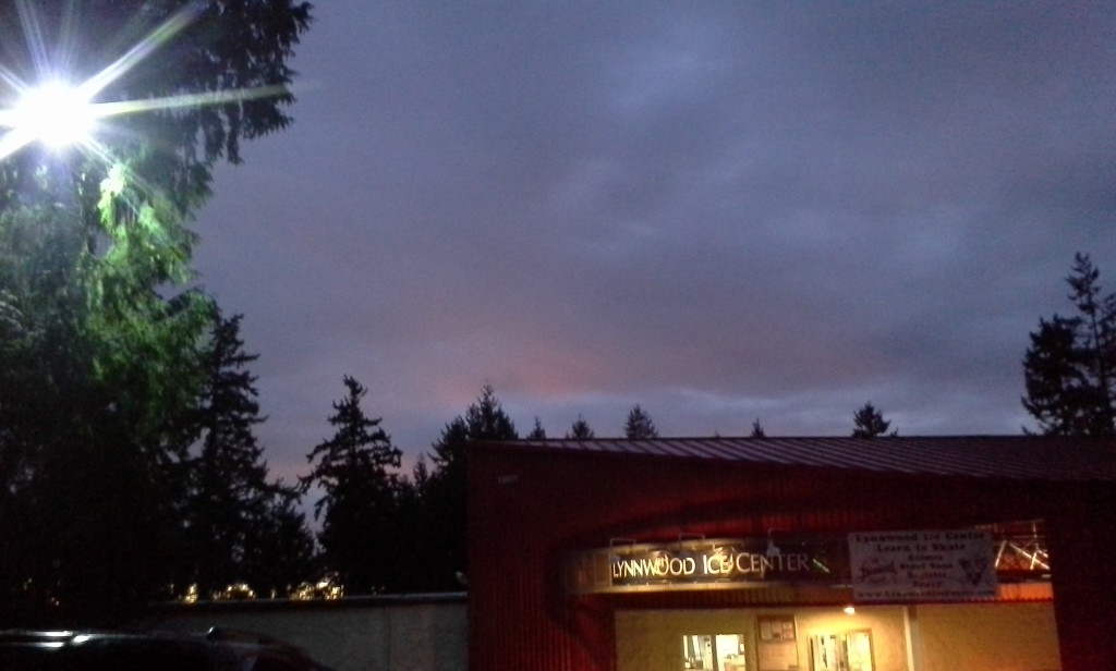 Dawn at the rink. Pretty sky. I'm arriving at a hockey game 1.5 hours away BEFORE DAWN!