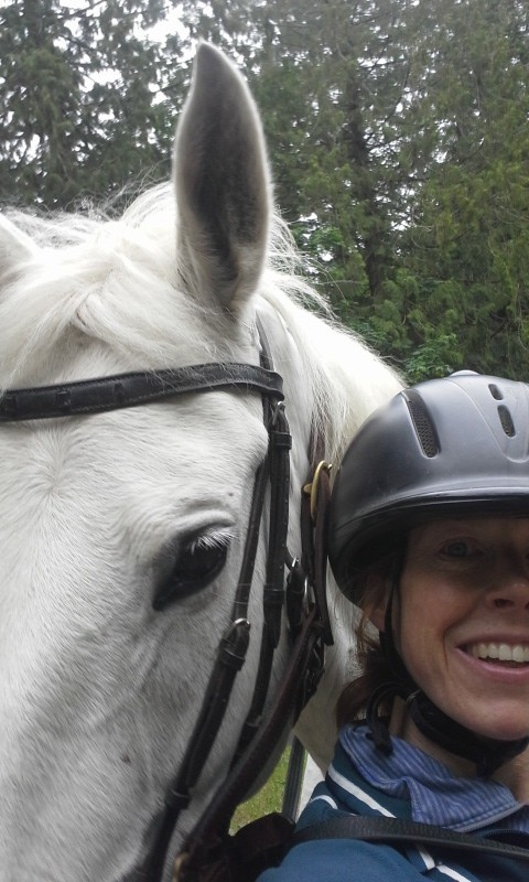 This morning I rode in a dressage clinic again (they are three days long) and then took Emmy on a trail ride. We rode around in the warm-up ring because I have a show next weekend (AGAIN right after a roller hockey game!) and while cantering my phone flew out. She tried to kick it on its way down into the sand. Pretty funny. So while I was off retrieving it, I decided it was time for a selfie. Emmy hates selfies. She was in the middle of rubbing her head on me and knocking me over. Thankfully I am very accustomed to being shoved - Sam likes to throw me around!