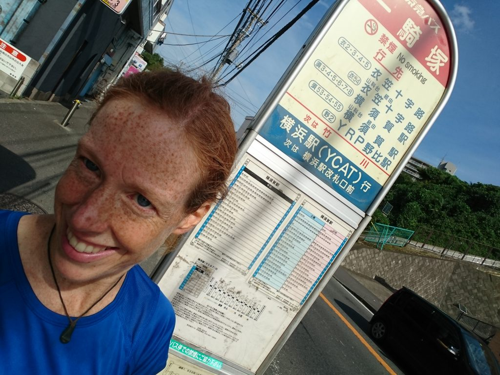 """Buses in Japan - they just make me laugh. I think even the locals find them inscrutable. I know at least 4 buses go back to Yokosuka. I can tell that much from studying routes on the web and making out the kanji on the sign. But WHEN? When do they go? You can look at the row for 1300 (the hour I am studying for transit back home) and you tell me when buses going to Yokosuka stop. Even if you could just tell me buses 6 and 8. When do they stop at this bus stop? I asked a professional man in a suit today and he graciously gave it his best effort, even consulting with a sweet older woman with a purple parasol and matching hair. Still a question mark. Take the next one, he said. But when I questioned the driver: """"Sumimasen? Yokosuka?"""" and got a briskly crossed pair of arms in reply...I just stepped back and laughed literally out loud. It is hysterical. I just run to the stop, hope to see a line of people, and wait."""
