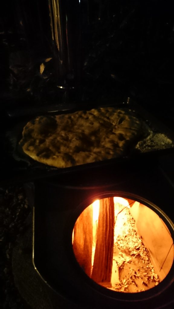 My new rice cooker being used to bake flatbread. So much fun to have a fire put to good use! I really lamented not having a fire here and it seems that is possible. Not only that...we can cook on it! I love this $50 furnace which a top that holds a rice pot.